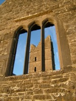 Looking through a church window toward the tower at Moyne Abbey, Co. Mayo