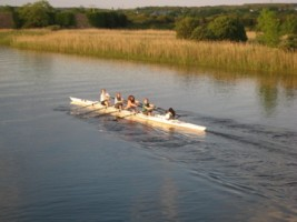 Young people rowing on the River Corrib close to Galway City